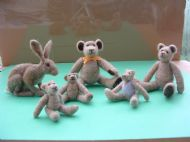 five needlefelted rabbits and a hare.