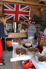 Sue Tanner in full Jubilee swing, surrounded by some of the wonderful cakes.