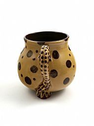 Spotty creature mug tail view