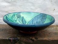 Side view of shallow green leafy bowl