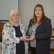 Marion Lewis accepting the Community Champion Award