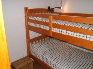 Single bedroom with bunk beds, wardrobe & window