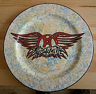 the background of this aerosmith plate was decorated using a natural sea sponge to stipple the glaze on. cost �22