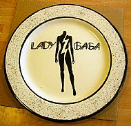 the rim of this lady gaga plate was decorated using a fleckle glaze called papparazzi. what a coincidence eh? cost �22