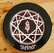 the blood splatter on this slipknot plate was achieved by using wax resist. cost �22