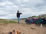 trefoil guild members campfire on brora beach