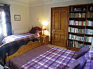 The purple room with king-size and single bed bed