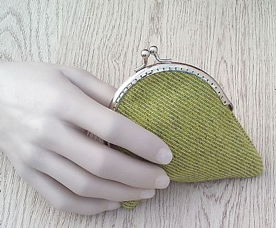 hand holding green donegal purse by roses workshop