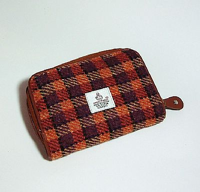 orange purple purse showing harris tweed label