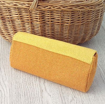 back of yellow orange clutch bag