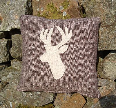 brown harris tweed cushion with cream stag applique from roses workshop