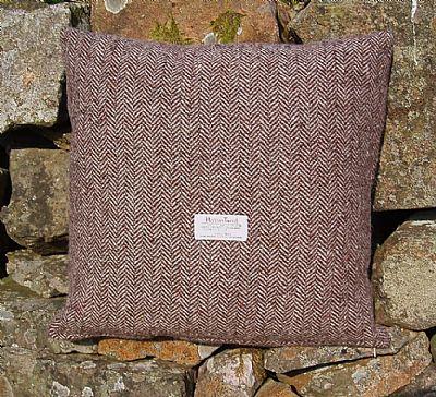brown herringbone harris tweed cushion showing the orb label