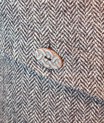 close-up ofceltic style button on harris tweed cushion