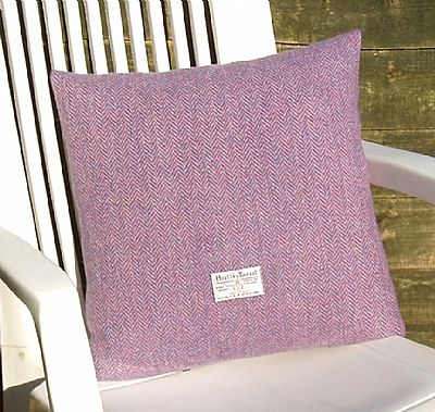 pink harris tweed cushion showing orb label
