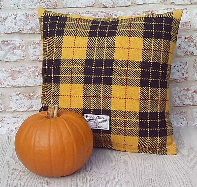 orb label on yellow harris tweed macleod cushion by roses workshop