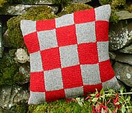 Knitted Shetland wool cushion red grey squares