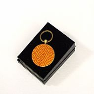 Harris tweed keyring round orange herringbone
