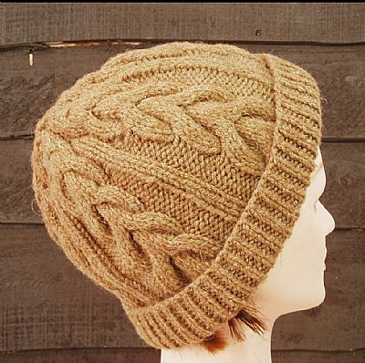 back of natural brown castlemilk moorit cable beanie
