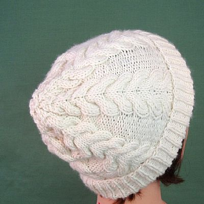 back of cream aran cable beanie from roses workshop