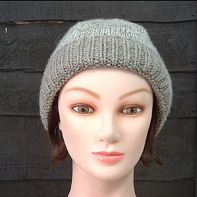 speckled brown bobble hat with brim turned back