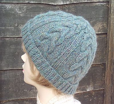 cable detail on women's green wool hat by roses workshop