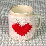 Cream heart mug cosy