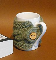 Green wool knitted mug cosy with wooden button