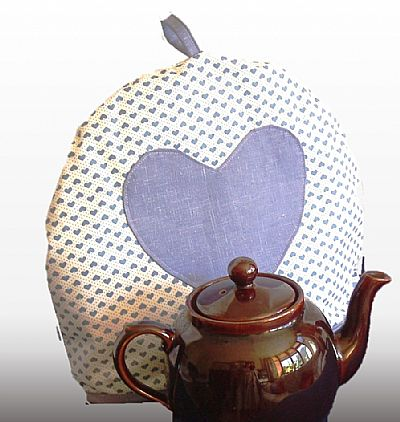 cotton tea cosy with blue applique hesrt by roses workshop