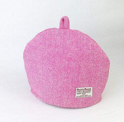 orb label on harris tweed pink and cream tea cosy by roses workshop