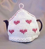 Pink hearts knitted tea cosy