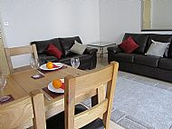 Dining area and sofas.
