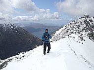 Winter returns! Ed on Beinn Fhada, Kintail