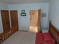 Double bedroom and en-suite wet room shower.