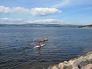 canoes launched from the steps opposite the cottage on their way to fort george