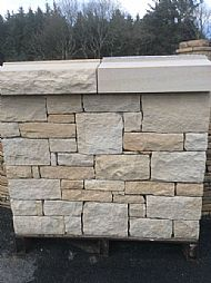 Buff and white sandstone cladding