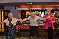 Pat, Ann, Margaret doing their best to dance