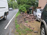 Wall demolished by car