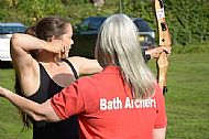 maria west heilberg being guided to the target at bath archers