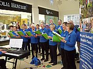 Singing outside Chisholm Hunter Jeweller