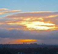 a new dawn: sunrise over north glasgow