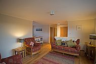 The  open plan lounge of the cottage which has wonderful views across the loch and Cuillin Mountains