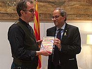 I present a copy of Catalonia Reborn to President Quim Torra of Catalunya