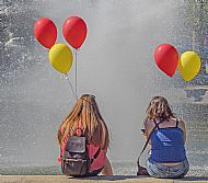 Girls with baloons in a Warsaw park