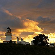 sunset over cromarty lighhouse