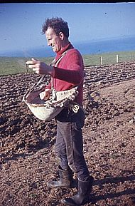 HPA189   Jimmy Towrie sowing oats with a 'hap', late 1960's (R. Towrie)