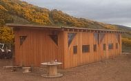 Black Isle yurts barn with cladding and windows