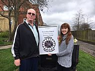 Chairman Cllr Andrew Pearson presents Rebekha Watret with a display replica of her winning logo design