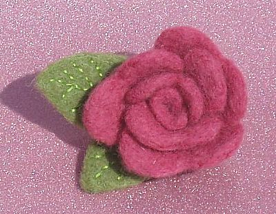 pink needle-felt rose brooch by roses felt workshop