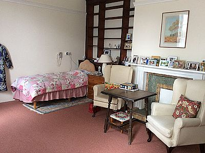 a bedroom at letheringsett hall  residential care home - holt