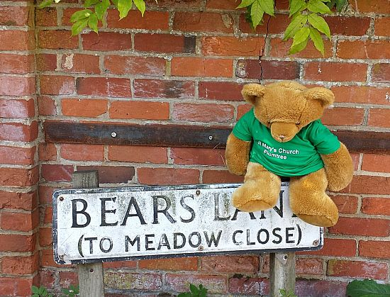 me with the sign to bears lane